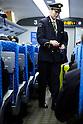 Osaka, JP - January 21, 2015 : A Japanese conductor of Shinkansen bullet train checks the tickets of the passengers who traveling to Osaka from Tokyo. (Photo by Rodrigo Reyes Marin/AFLO)