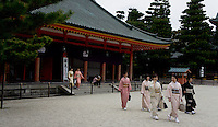 women in traditional kimono leaving Heian shrine in Kyoto, Japan