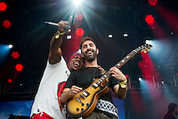 DJ Lockhart and guitarist Amir Amor onstage as Rudimental perform during the Governors Ball Music Festival on Randall's Island Park in New York, Friday June 5, 2015.  AFP PHOTO/TREVOR COLLENS