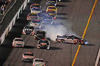 Jul. 4, 2008; Daytona Beach, FL, USA; Nascar Nationwide Series driver Mike Wallace spins on the last lap during the Winn-Dixie 250 at Daytona International Speedway. Mandatory Credit: Mark J. Rebilas-