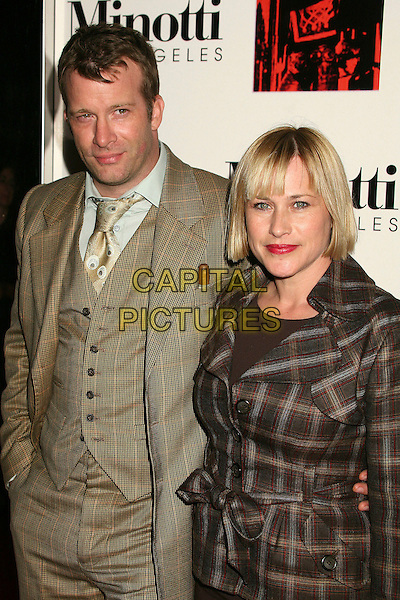 THOMAS JANE & PATRICIA ARQUETTE.The 2006 Art of Elysium Annual Art,  Benefit at Minotti, Los Angeles, California, USA,.02 December 2006..half length plaid tartan brown jacket couple.CAP/ADM/BP.©Byron Purvis/AdMedia/Capital Pictures.