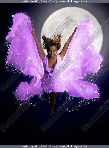 Beautiful young fairy woman with butterfly wings flying at night over a full moon
