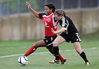 BOYDS, MARYLAND - July 21, 2012:  Mikaela Howell (8) of DC United Women challenges Stephanie Goddard (21) of the Virginia Beach Piranhas during a W League Eastern Conference Championship semi final match at Maryland Soccerplex, in Boyds, Maryland on July 21. DC United Women won 3-0.