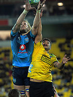 Bulls RG Snyman beats Hurricanes' Isaia Walker-Leawere to lineout ball during the Super Rugby quarterfinal between the Hurricanes and Bulls at Westpac Stadium in Wellington, New Zealand on Saturday, 22 June 2019. Photo: Dave Lintott / lintottphoto.co.nz