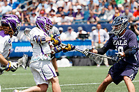 Sean Eccles (#38) attempts to shoot past a Yale defender as Yale defeats UAlbany 20-11 in the NCAAA semifinal game at Gillette Stadium, May 26.