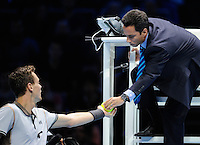Tomas Berdych (CZE) hands the chair umpire a defective tennis ball during Day One of the Barclays ATP World Tour Finals 2015 played at The O2, London on November 15th 2015