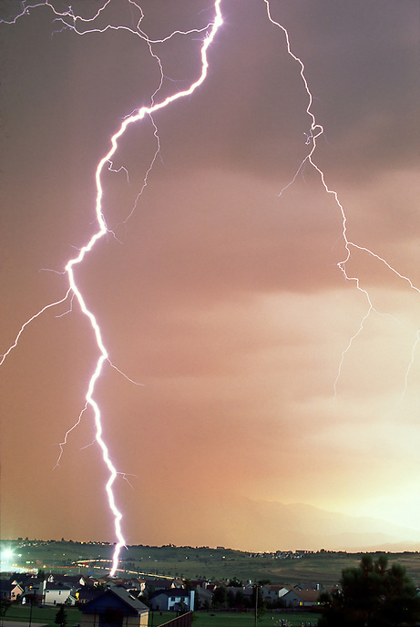 Lightning strikes a house in the Stetson Hills area of eastern Colorado Springs Colorado during a monsoonal summertime thunderstorm.