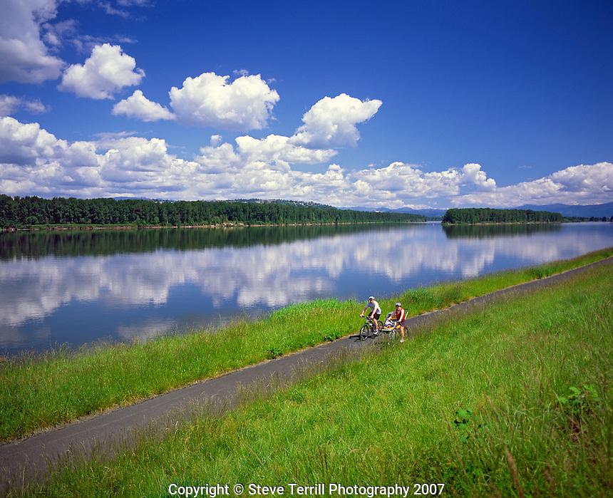 Bike riders on path along The Columbia River in Multnomah County, Oregon