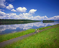 Bike riders on path along The Columbia River in Multnomah County, Oregon