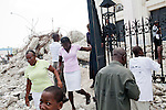 People climb off of the rubble of the destroyed national cathedral after a church service on July 11, 2010 in Port-au-Prince, Haiti.