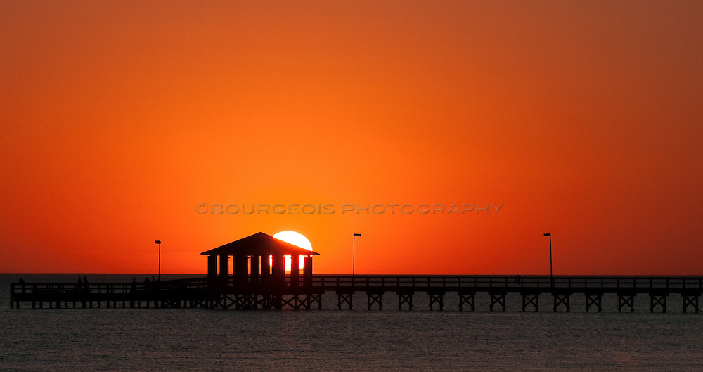 Silhouetted Biloxi Lighthouse Pier At Sunset Bourgeois Photography