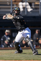 Catcher Mike Murray (16) of the Wake Forest Demon Deacons makes a throw to first base versus the Clemson Tigers during the first game of a double header at Gene Hooks Stadium in Winston-Salem, NC, Sunday, March 9, 2008.