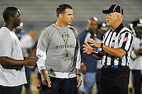 12 August 2011:  FIU Football Head Coach Mario Cristobal speaks with an official after a scrimmage held as part of the FIU 2011 Panther Preview at University Park Stadium in Miami, Florida.