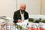 Editor Eamon Fleming sign's copies of  a new book The Home Place  ' An Baile' which tells the story of the disappearing legacy of Kerry's vernacular architecture at the Launch at County Library on Thursday
