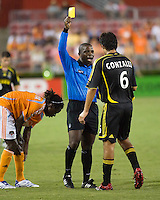 Referee Abbey Okulaja shows Columbus Crew defender Marcos Gonzalez (6) a yellow card caution. The Houston Dynamo tied the Columbus Crew 1-1 in a regular season MLS match at Robertson Stadium in Houston, TX on August 25, 2007.