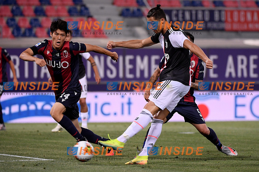 Takehiro Tomiyasu of Bologna FC and Cristiano Ronaldo of Juventus compete for the ball during the Serie A football match between Bologna FC and Juventus at Dall'Ara stadium in Bologna ( Italy ), June 22th, 2020. Play resumes behind closed doors following the outbreak of the coronavirus disease. <br /> Photo Federico Tardito / Insidefoto