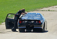 May 22, 2011; Topeka, KS, USA: NHRA pro stock driver Erica Enders reacts after losing in the first round during the Summer Nationals at Heartland Park Topeka. Mandatory Credit: Mark J. Rebilas-