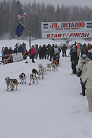 Garry McKeller  leaves the start line of the 2006 Jr. Iditarod race from Willow Lake, Alaska   ..Photo by Ben Schultz
