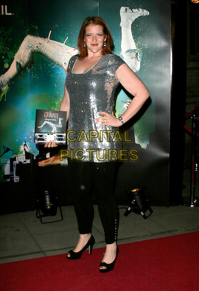 "MIKYLA DODD .VIP Gala Premiere of Cirque de Soleil's ""Quidam"" at the Royal Albert Hall, London, England,  January 6th 2009.Cirque de Soleil full length tunic dress black trousers leggings hands on hips silver sequined sequins .CAP/AH.©Adam Houghton/Capital Pictures"