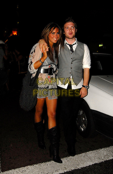 CHRIS FOUNTAIN & GUEST.Afterparty at Mahiki nightclub for the TV Quick & TV Choice Awards, The Dorchester Hotel, London, England. .September 3rd 2007.full black trousers grey gray waistcoat dress white sheer belt bag purse boots arm over shoulder .CAP/SW.©Stephen Walters/Capital Pictures