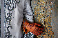 "Winda Wahyuni holds hands with her husband Ahmad Yasir Saputra after they got married in a mosque in Banda Aceh December 9, 2012. Winda and Ahmad Yasir, who met a year ago on the Facebook married in a religious ceremony in a local mosque in Banda Aceh. Dating on social networks become increasingly popular in Aceh where, under the Sharia law, it is a crime for an unmarried man and woman who are not related by blood to associate in an ""isolated place."" Aceh is Indonesia's only province to have implemented Sharia or Islamic laws. Human right activists warn some of sharia laws in IndonesiaÕs Aceh province violate rights of many people - predominantly the poor, women, minority and youths.   REUTERS/Damir Sagolj (INDONESIA)"