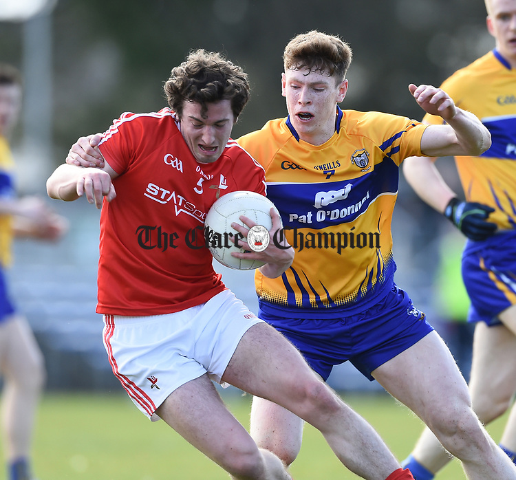 Eoghan Lafferty of Louth  in action against Sean O Donoghue of Clare during their national League game in Cusack Park. Photograph by John Kelly.
