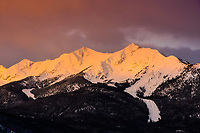 The Tenmile Range near Breckenridge , Colorado runs for approximately 10 miles (hence its name) and its peaks are named- Peak 1 through Peak 10. Here, Peaks 1 and Peak 2 are set a glow by the rising Sun.