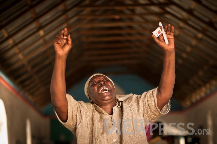 HAITI - CAP HAITIEN - Voodoo beleiver during ceremonies