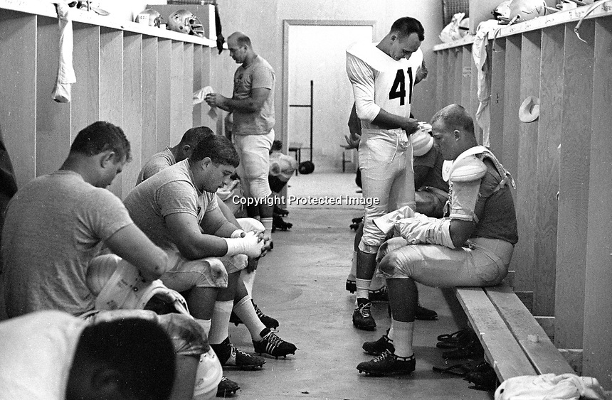 Oakland Raider dressing room in Santa Rosa 1965.<br />standing in the center is Dick Wood QB from Auburn.<br />(photo/Ron Riesterer)