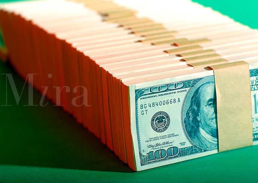 Stacks of one hundred dollar bills lined up