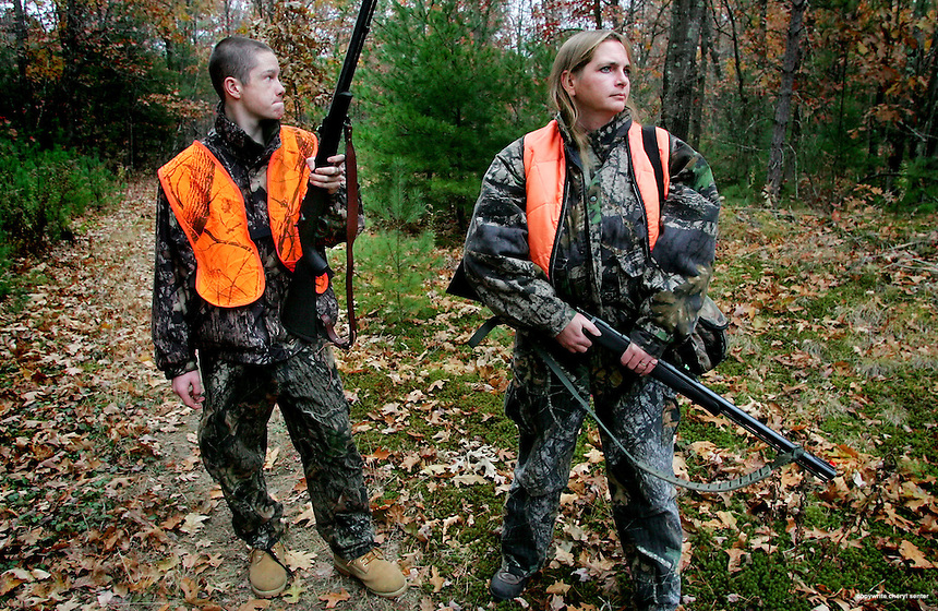 Chester: Candy Menard and her 15 year old son Buddy stop and listen as they walk a trail hunting deer.  Photo by Cheryl Senter/Eagle-Tribune Friday, November 04, 2005