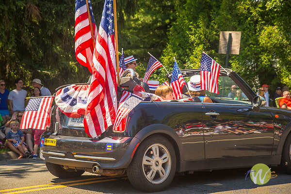 4th of July Parade, Madison, CT. Mini Cooper car with flags