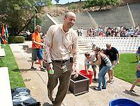 Occidental College President Jonathan Veitch takes on the class of 2011 during an epic water balloon fight at the end of commencement rehearsal on Friday, May 13, 2011 in the Remsen Bird Hillside Theater. (Photo by Marc Campos, Occidental College Photographer)