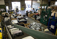 12/4/2008 3:32:02 PM -- Seattle, WA.Computers travel up a ramp to be broken down for recycling at Total Reclaim Inc., Environmental Services in Seattle Thursday Dec. 4, 2008.