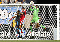 CHESTER, PA - AUGUST 12, 2012:  Bakary Soumare (4) of the Philadelphia Union loses a cross to  Sean Johnson (25) of the Chicago Fire during an MLS match at PPL Park, in Chester, PA on August 12. Fire won 3-1.