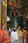 Israel, Capernaum, Greek Orthodox priests at the Church of the Twelve Apostles on the day of St. Petar and St. Paul