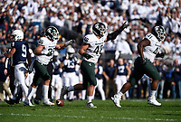 STATE COLLEGE, PA - OCTOBER 13: Michigan State LB Joe Bachie (35), DE Kenny Willekes (48), and DT Gerald Owens (41) celebrate after a fumble recovery and change of possession. The Michigan State Spartans defeated the Penn State Nittany Lions 21-17 on October 13, 2018 at Beaver Stadium in State College, PA. (Photo by Randy Litzinger/Icon Sportswire)