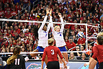 KANSAS CITY, MO - DECEMBER 16: Rhamat Alhassan (1) and Carli Snyder (4) of the University of Florida reach to block a shot by Lauren Stivrins (26) of the University of Nebraska during the Division I Women's Volleyball Championship held at Sprint Center on December 16, 2017 in Kansas City, Missouri. (Photo by Jamie Schwaberow/NCAA Photos via Getty Images)