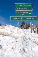 A road sign and snowbank in Copper Harbor, Michigan shows its at the opposite end of U.S. Highway 41 from Miami, Florida.