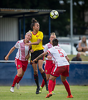 Natalie Murray of Watford Ladies clears from Leah Dunnage of Stevenage Ladies during the pre season friendly match between Stevenage Ladies FC and Watford Ladies at The County Ground, Letchworth Garden City, England on 16 July 2017. Photo by Andy Rowland / PRiME Media Images.