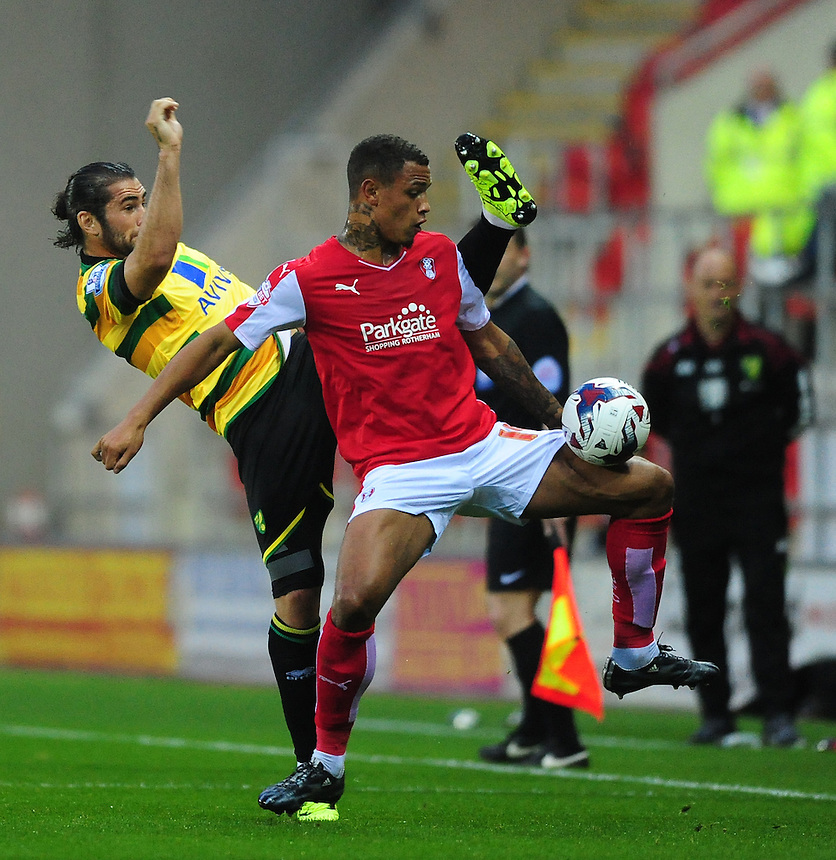 Rotherham United's Jonson Clarke-Harris shields the ball from Norwich City's Bradley Johnson<br /> <br /> Photographer Chris Vaughan/CameraSport<br /> <br /> Football - Capital One Cup Second Round - Rotherham United v Norwich - Tuesday 25th August 2015 - New York Stadium - Rotherham<br />  <br /> &copy; CameraSport - 43 Linden Ave. Countesthorpe. Leicester. England. LE8 5PG - Tel: +44 (0) 116 277 4147 - admin@camerasport.com - www.camerasport.com