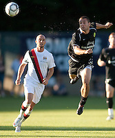 Portland Timbers midfielder Tony McManus heads the ball past Manchester City midfielder Stephen Ireland during a match at Merlo Field in Portland Oregon on July 17, 2010.
