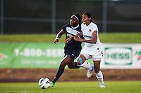 Sky Blue FC forward Danesha Adams (9) is marked by Washington Spirit defender Candace Chapman (5). Sky Blue FC defeated the Washington Spirit 1-0 during a National Women's Soccer League (NWSL) match at Yurcak Field in Piscataway, NJ, on July 6, 2013.