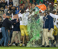 Head coach Brian Kelly is showered with Gatorade.