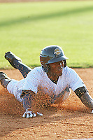Charleston RiverDogs outfielder Mikeson Oliberto #19 sliding into third base during a game against the Augusta GreenJackets at Joseph P. Riley Jr. Ballpark on April 13, 2014 in Charleston, South Carolina. Augusta defeated Charleston 2-1. (Robert Gurganus/Four Seam Images)