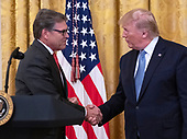 """United States Secretary of Energy Rick Perry, left, shakes hands with US President Donald J. Trump after making remarks on """"America's Environmental Leadership"""" in the East Room of the White House in Washington, DC on Monday, July 8, 2019.<br /> Credit: Ron Sachs / CNP"""