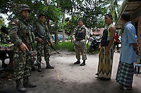 Soldiers stands guard outside the house of the Malee family that has just been attacked by unknown gunmen inside the house killing their daughter. Thailand is struggling to keep up appearances as the land of smiles has to face up to its troubled south. Since 2004 more than 3500 people have been killed and 4000 wounded in a war we never hear about. In the early hours of January 4th 2004 more than 50 armed men stormed a army weapons depot in Narathiwat taking assault rifles, machine guns, rocket launchers, pistols, rocket-propelled grenades and other ammunition. Arsonists simultaneously attacked 20 schools and three police posts elsewhere in Narathiwat. The raid marked the start of the deadliest period of armed conflict in the century-long insurgency. Despite some 30,000 Thai troops being deployed in the region, the shootings, grenade attacks and car bombings happen almost daily, with 90 per cent of those killed being civilians. 24.09.07. Photo: Christopher Olssøn