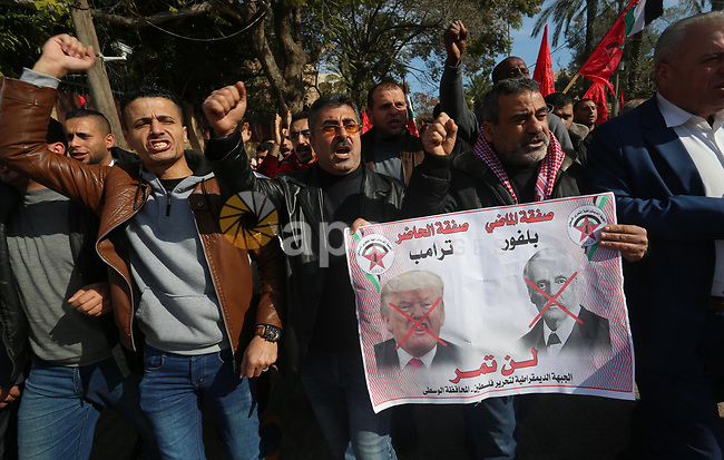 "Palestinians supporters of the Democratic Front for the Liberation of Palestine (DFLP) holds banners depicting U.S. President Donald Trump during a protest against the U.S. Middle East peace plan, in front of the headquarter United Nation ""UNSCO"", in Gaza City, on January 27, 2020. Photo by Ashraf Amra"