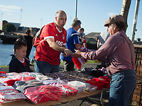 A Fan buying a scarf from a trader before the Sky Bet Championship match between Nottingham Forest and Millwall at the City Ground, Nottingham, England on 4 August 2017. Photo by James Williamson / PRiME Media Images.