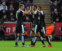 Riyad Mahrez of Leicester City (C) celebrates his second goal with team mates during the Barclays Premier League match between Swansea City and Leicester City at the Liberty Stadium, Swansea on December 05 2015